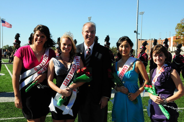 Katie Kelien was crowned Homecoming Queen posting with Dr. Michael Carter and other candidates