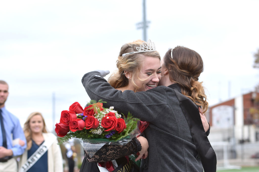 Jessica McCandless hugs the new queen, Rachel Mobley