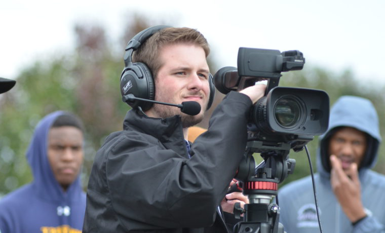 broadcast student on football field